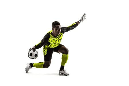 one soccer player goalkeeper man throwing ball. Silhouette isolated on white studio background Stock Photo