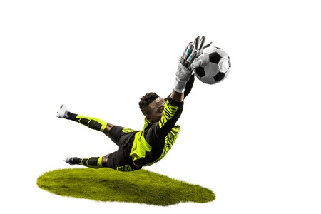 Male soccer player goalkeeper catching ball in jump. Silhouette of fit man with ball isolated on white studio background 스톡 콘텐츠