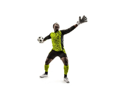 one soccer player goalkeeper man throwing ball. Silhouette isolated on white studio background Фото со стока