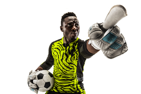 One african male soccer player goalkeeper pointing away and screaming isolated on white background. Appeal to the referee, order to defenders and human emotions concept
