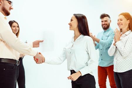 Boss approving and congratulating young successful employee of the company for her successes and good work. National Employee Appreciation Day, businesswoman, businessman, business, success, admire, career growth concept. Stock Photo - 117220352