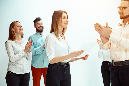 Boss approving and congratulating young successful employee of the company for her successes and good work. National Employee Appreciation Day, businesswoman, businessman, business, success, admire, career growth concept. Stock Photo