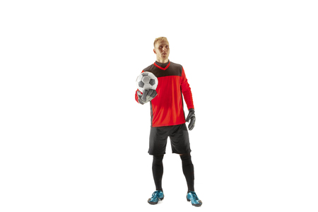 One male soccer player goalkeeper standing and holding ball. Silhouette isolated on white studio background