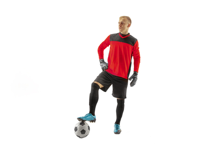 One male soccer player goalkeeper standing and holding ball. Silhouette isolated on white studio background Imagens