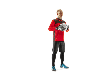 One male soccer player goalkeeper standing and holding ball. Silhouette isolated on white studio background 스톡 콘텐츠