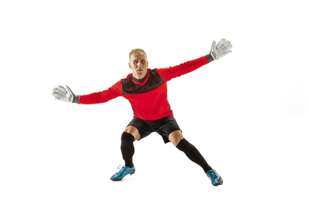 Goalkeeper ready to save on white studio background. Soccer football concept