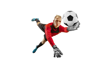 Male soccer player goalkeeper catching ball in jump. Silhouette of fit man with ball isolated on white studio background Imagens