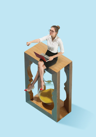 Flat isometric view of businesswoman are afraid of the symbol deadline. Conceptual collage. Business processes, workplace concepts. Human emotions concept. Miniature people. 写真素材