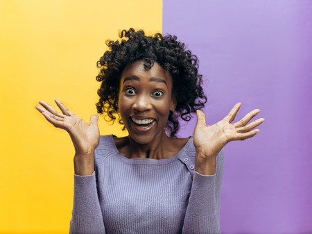 I won. Winning success happy woman celebrating being a winner. Dynamic image of african female model on studio background. Victory, delight concept. Human facial emotions concept. Trendy colors