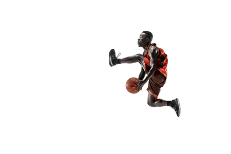 Full length portrait of a basketball player with a ball isolated on white studio background. advertising concept. Fit african anerican athlete jumping with ball. Motion, activity, movement concepts. Stok Fotoğraf