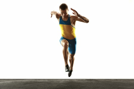 Young caucasian man running isolated on white studio background. One male runner or jogger. Silhouette of jogging athlete with shadows.