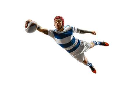 The silhouette of one caucasian rugby male player isolated on white background. Studio shot of fit man in motion or movement with ball. Jump and action concept. An incredible strain of all forces Фото со стока