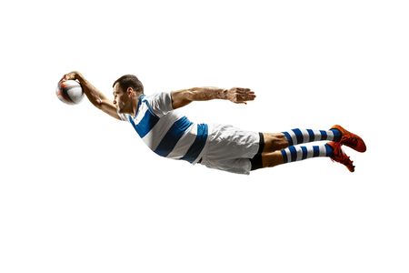 The silhouette of one caucasian rugby male player isolated on white background. Studio shot of fit man in motion or movement with ball. Jump and action concept. An incredible strain of all forces Banco de Imagens