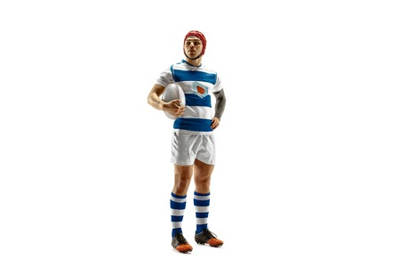 The silhouette of one caucasian rugby man player isolated on white background. Studio shot of fit man in motion or movement with ball. Jump and action concept. An incredible strain of all forces. Фото со стока
