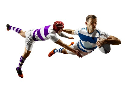 The silhouette of two caucasian rugby male players isolated on white background. Studio shot of fit men in motion or movement with ball. Jump and action concept. An incredible strain of all forces. Banco de Imagens