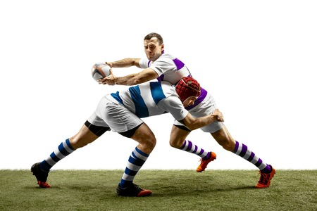 The silhouette of two caucasian rugby male players isolated on white background. Studio shot of fit men in motion or movement with ball. Jump and action concept. An incredible strain of all forces. Фото со стока