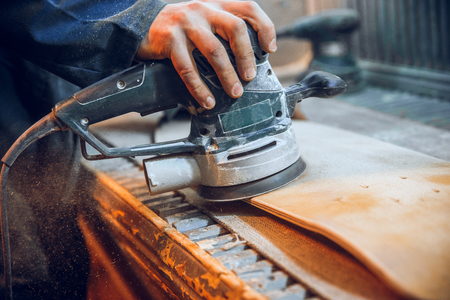 Carpenter using circular saw for cutting wooden boards. Construction details of male worker or handy man with power tools Banque d'images - 118696227