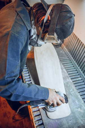 Carpenter using circular saw for cutting wooden boards. Construction details of male worker or handy man with power tools Banque d'images - 118696241