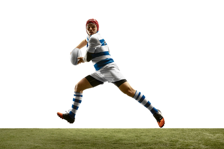 The silhouette of one caucasian rugby man player isolated on white background. Studio shot of fit man in motion or movement with ball. Jump and action concept. An incredible strain of all forces. Banque d'images