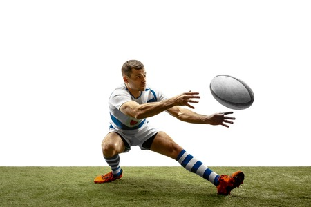 The silhouette of one caucasian rugby man player isolated on white background. Studio shot of fit man in motion or movement with ball. Jump and action concept. An incredible strain of all forces. Imagens