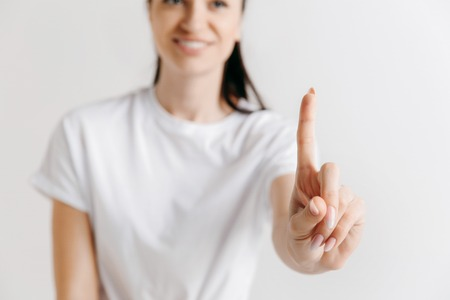 Businesswomans finger touching empty space, modern business background concept - can be used for insert search bar, text or pictures. Imagens