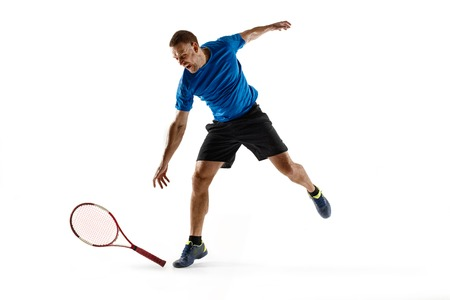 Stressed tennis player throwing and breaking a racket in anger and rage at court. Human emotions, defeat, crash, failure, loss concept. Athlete isolated on white Stock Photo
