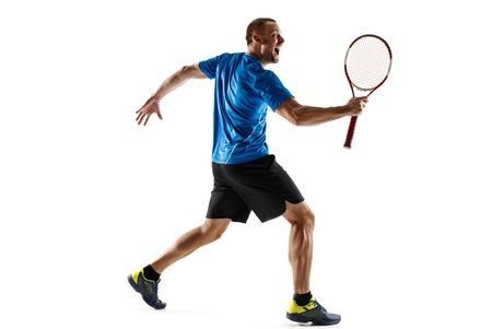 Portrait of a handsome male tennis player celebrating his success isolated on a white studio background. Human emotions, winner, sport, victory concept Standard-Bild