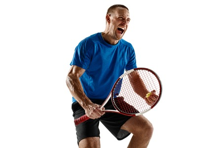 Portrait of a handsome male tennis player celebrating his success isolated on a white studio background. Human emotions, winner, sport, victory concept