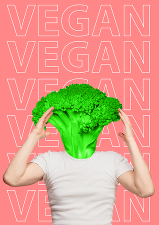 Vegan has only green thoughts. Surprised man in white short with green juicy broccoli as a head on trendy coral background. Healthy food and veganism concept. Modern design. Contemporary art collage.