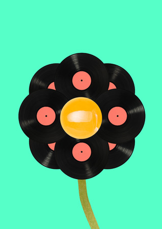 Voice of immortal music - live vinyl records. Alternative black growing flower with music collections in its rounded petals against blue background. Modern design. Contemporary pop-art collage.