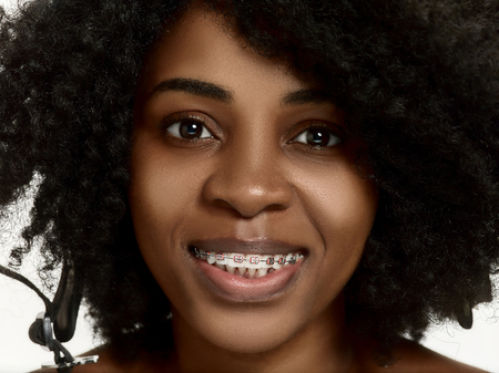 Portrait of a young black african american woman smiling with braces