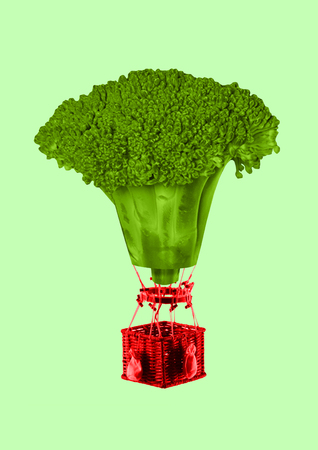 Veganism gives natural feelings. A vegans trip or journey. Balloon formed green juicy broccoli with the red basket flying up against light mint background. Modern design. Contemporary art collage.