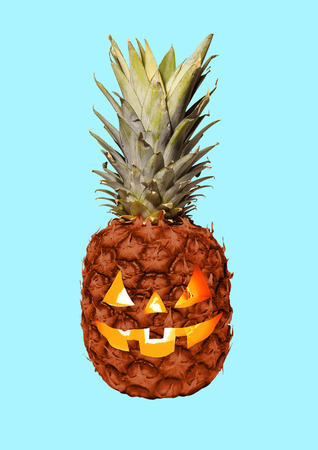 Lets go on halloween party. An alternative view of celebrating the most terrible autumns holidays. A pineapple as a pumpkin with the candles inside. Modern design. Contemporary art collage. Standard-Bild