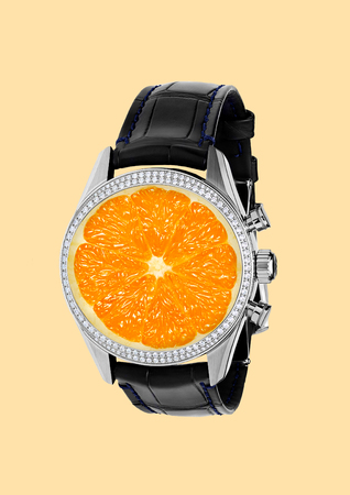 Its time for vitamins. A watches with black leather and diamonds with juicy orange in centre as a clock board. Negative space. Healthy food concept. Modern design. Contemporary art collage. Stock Photo