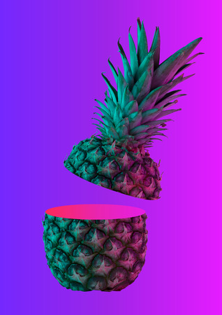 A neon pineapple. Rich inner world, wide soul can hide in grey cover. A fruit cut in two peaces is bright pink inside on gradient background. Human nature. Modern design. Contemporary art collage.
