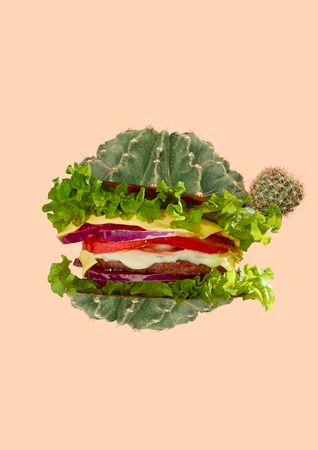 An alternative lunch or break in desert. Green cactus as a bun for humburger or cheeseburger with salad, meat and tomato. Negative space. Food concept. Modern design. Contemporary art collage.