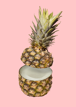 A paradox. Hidden sense of usual thing or deep thinks inside. An exotical fruit is pineapple outside and coconut inside agains pink background. Food concept. Modern design. Contemporary art collage.