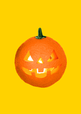 Lets go on halloween party even if its spring or summer. A juicy orange with the flaming candles inside as a pumpkin on yellow background. Holiday concept. Modern design. Contemporary art collage.