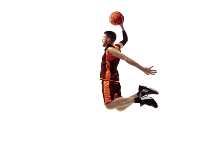 Full length portrait of a basketball player with ball isolated on white background. Advertising concept. Fit caucasian athlete jumping at studio. Motion, activity, movement concepts. Reklamní fotografie