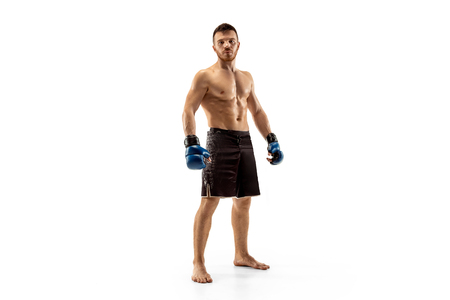 Human weakness and sin fighter. Single professional warrior isolated on white studio background. Fit muscular caucasian athlete or boxer fighting. Sport, competition, human emotions concept.