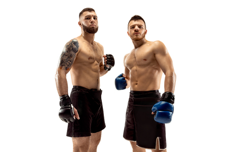 Ready to grow up. Two professional fighters posing isolated on white studio background. Couple of fit muscular caucasian athletes or boxers standing. Sport, competition and human emotions concept. Stockfoto