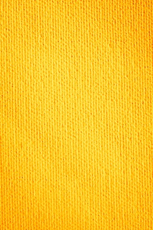 Close up paper texture background. Abstract seamless yellow pattern. Goya Canvas. Stock Photo