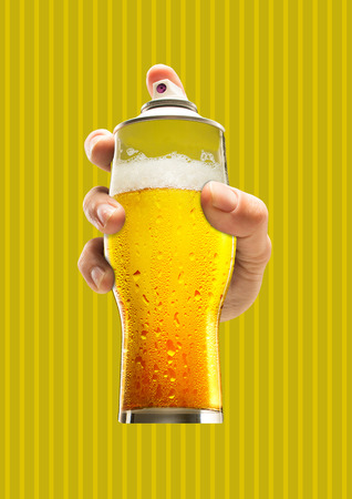 Street art. Male hand holding a glass of cold beer as a spray cannister against yellow-braun background. Modern design. Contemporary art collage. Concept of arts, drawing, drinks or weekend chilling.