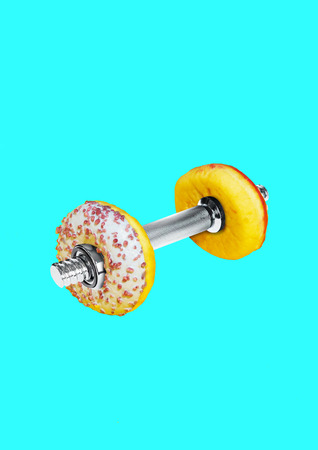 Fight for your fit. Burn calories faster. Barbell with glazed sweet donut as a plates against blue background. Negative space. Modern design. Contemporary art collage. Concept of health and sport. Banque d'images