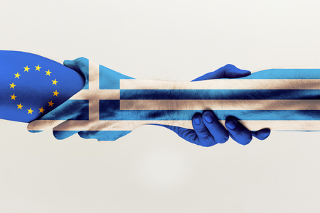 New chances. Male hands holding colored in blue EU and Greece flag isolated on gray studio background. Concept of help, commonwealth, partnership of countries, political and economical relations.
