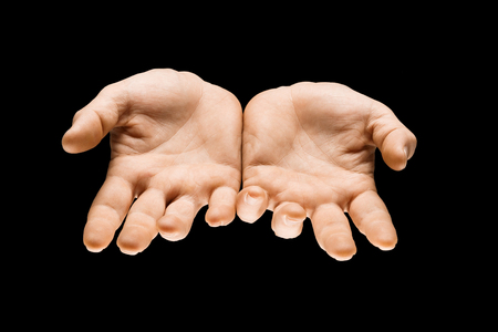 Getting an answer. Male hands demonstrating a request gesture or question sign isolated on black studio background. Concept of human relations, relationship, phycology or business. Stock Photo