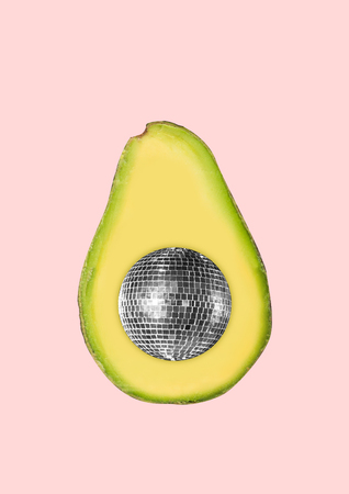 The summers vibes. A half of avocado with the discoball inside on trendy coral background. Negative space to insert your text. Modern design. Contemporary art collage. Concept of food, weekend.