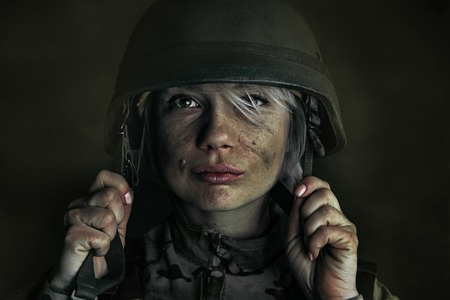 Death is not so terrifying as a fight with it. Close up portrait of young female soldier. Woman in military uniform on the war. Depressed and having problems with mental health and emotions, PTSD.