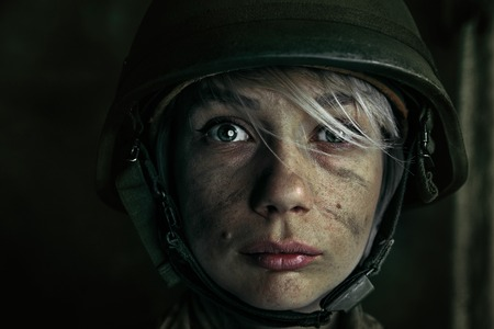 Only one chance to be alive. Close up portrait of young female soldier. Woman in military uniform on the war. Depressed and having problems with mental health and emotions, PTSD. Stok Fotoğraf