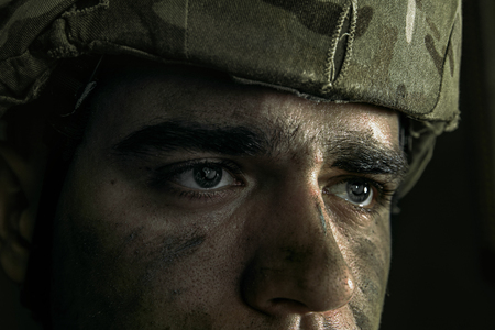 Close up portrait of young male soldier. Stock Photo